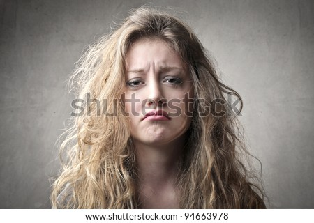 Beautiful woman with sad expression