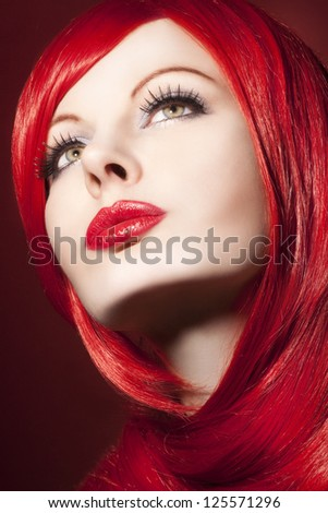 Beautiful woman with shiny red hair