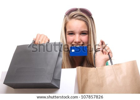 Beautiful woman with Shopping bag holding a credit card