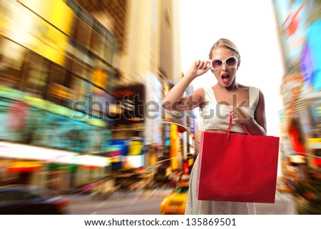 beautiful woman with shopping bag in the city