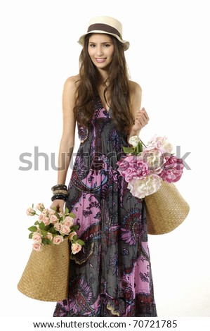 Beautiful woman with shopping bags and colorful flower