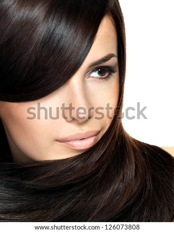 Beautiful woman with straight hair. Closeup portrait of a fashion model posing at studio.