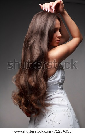 Beautiful woman with straight long hair - stock photo