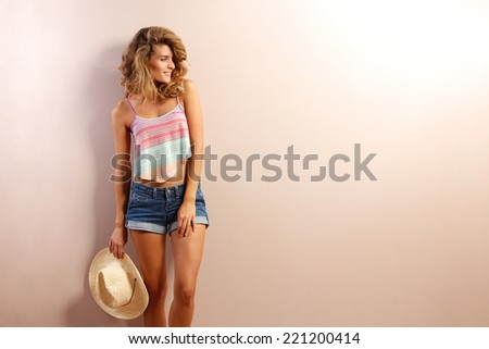 Shutterstock beautiful woman with straw hat smiling and happy . brown background