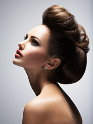 Beautiful woman with style hairstyle posing at studio