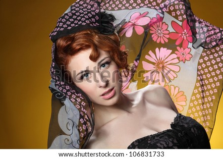 beautiful woman with the winds and red veil