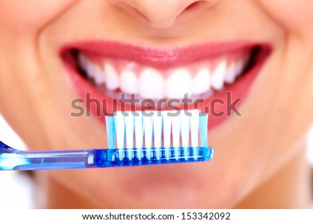 Beautiful woman with toothbrush. Dental care background.