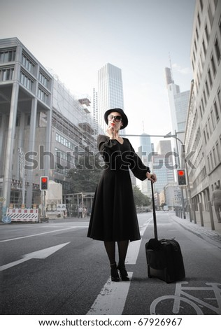 beautiful woman with trolley in the city
