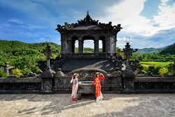 Beautiful  woman with Vietnam culture traditional dress ,Grand stairs in Imperial Khai Dinh Tomb in Hue, Vietnam