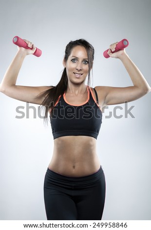 Beautiful woman with weights in her hands #249958846