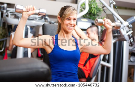 Beautiful woman working out in a fitness club