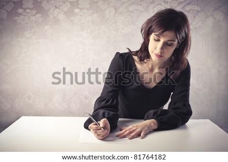 Beautiful woman writing a letter