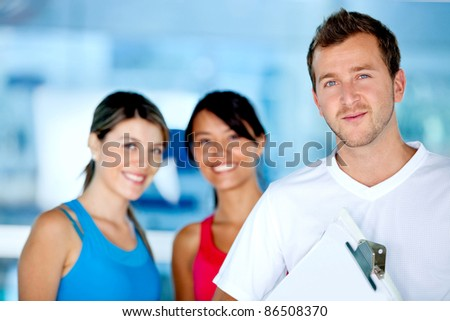 Beautiful women at the gym with their trainer