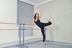 Beautiful women dancer practicing ballet at dancing studio
