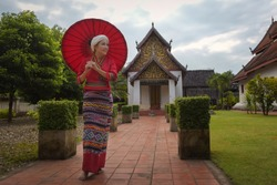 Beautiful women dressed in traditional Thai dresses in northern Thailand at Wat Phumin, Nan Province