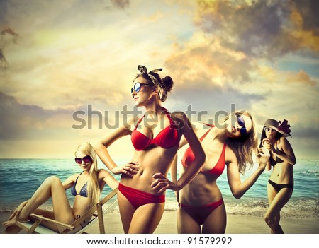 Beautiful women in bikini at the seaside