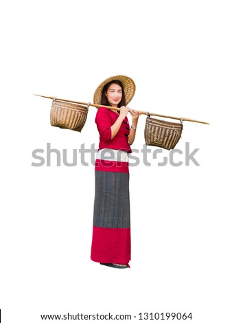 Beautiful women in Thai dress carry basket on shoulder isolated on white background with clipping path #1310199064