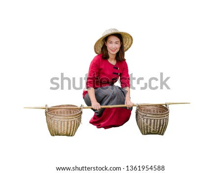 Beautiful women in Thai dress carry basket on shoulder isolated on white background with clipping path #1361954588