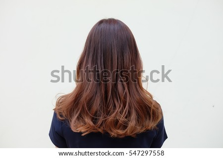 Beautiful women's hair with brown ash color,Gradient highlight and curly hairstyle. side view on white background. Stock photo ©