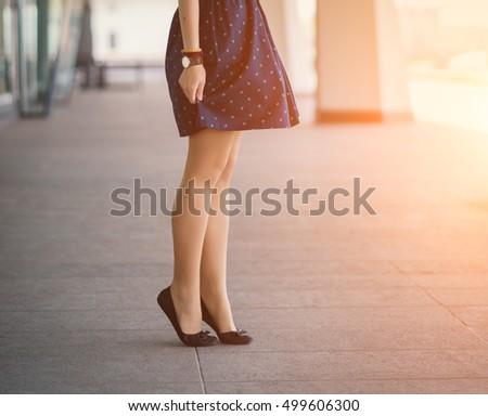 Beautiful women's legs in shoes.