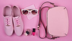 beautiful women's minimal set of fashion accessories on a pink background: shoes, sunglasses, perfume, nail polish and handbag. Ideal for blogs or magazines. Mock up.