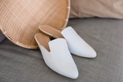 beautiful women's shoes on legs and layouts, leather white mules and loafers, in the interior of a room or office, a girl shoes, blue skirt and white shoes, a noble and elegant style, modern and trend