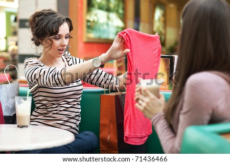 Beautiful women shopping for some clothes at a store