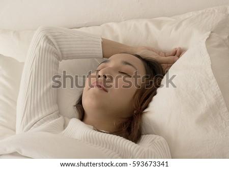 beautiful women sleep on bed in bedroom #593673341