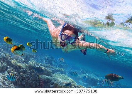 Shutterstock Beautiful women snorkeling in the tropical sea