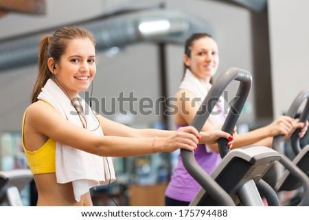 Beautiful women training in a gym