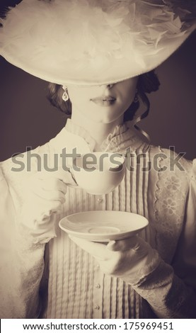 Beautiful Women With Cup Of Tea. Photo In Old Color Image Style.