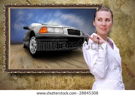 Beautiful women with keys of car on the grunge background