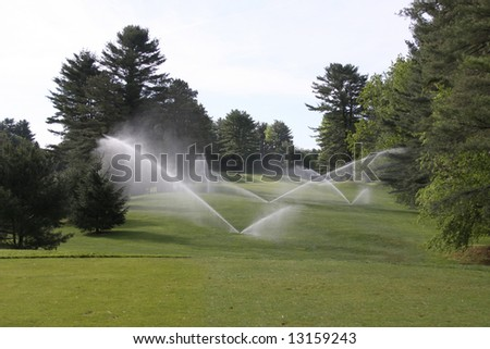 Beautiful Wooded Fairway with Sprinklers Operating