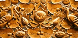 Beautiful wooden carving with flowers and birds photographed in close-up