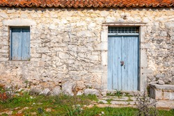 beautiful wooden doors from a very old traditional house in Peleta village in Greece