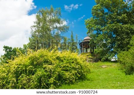 Beautiful Wooden Gazebo on the rock. Park near Czech national castle Kozel.