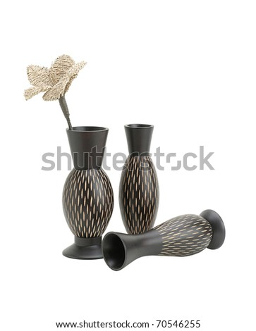 Beautiful wooden handmade vases with artificial flower isolated on white background