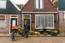 Beautiful wooden houses. Typical small Dutch houses facades in Volendam, Netherlands