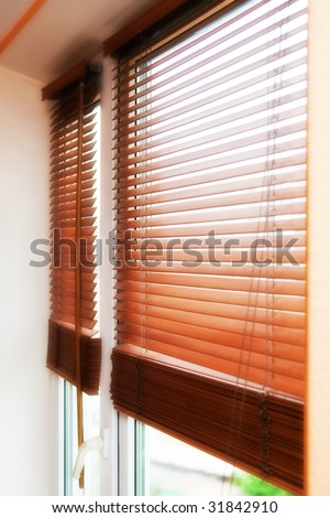 Beautiful wooden jalousie at a window