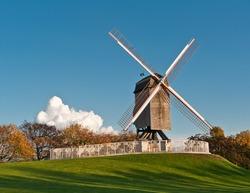 Beautiful wooden wind mill  Brugge, Belgium