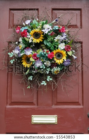 beautiful wreath on door - stock photo