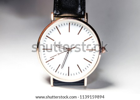 Beautiful wristwatch and white backdrop
