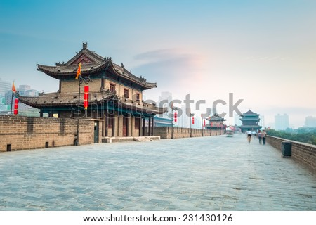 beautiful xian city wall and ancient tower at dusk , China  #231430126