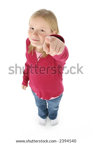 Beautiful 11 year old girl pointing at camera.  Blonde hair, blue eyes, standing in socks and casual.