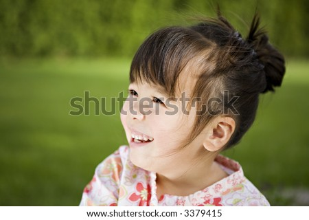 Beautiful 3-Year-Old Girl with a Happy Expression in her Backyard