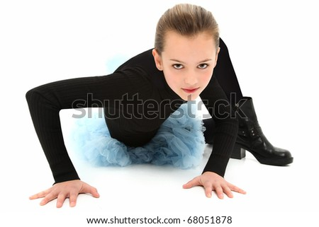 Beautiful 10 year old tomboy girl in biker boots and blue dance tutu over white background.