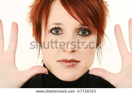 Beautiful 30 year old woman face close up with hands open to side.