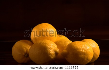 Beautiful yellow lemons isolated against a solid black background.