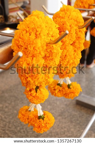 Beautiful Yellow Marigold Wreaths or Garlands, The Garland in Thai Tradition Style Used to Pay Respect to The Buddha. #1357267130