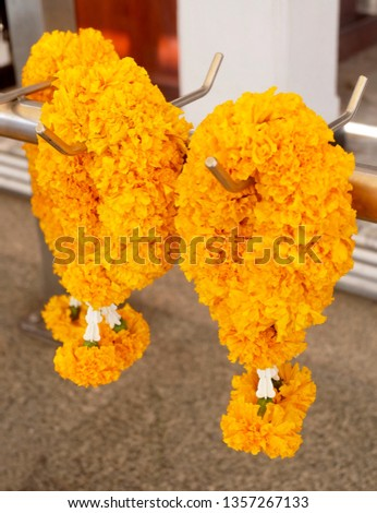 Beautiful Yellow Marigold Wreaths or Garlands, The Garland in Thai Tradition Style Used to Pay Respect to The Buddha. #1357267133